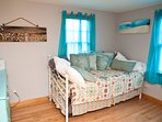 Smaller bedroom with day bed and trundle.