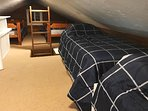 Guests will find additional sleeping in the loft area.