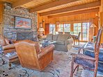 Unwind by the light of the gas and wood-burning stone fireplace.