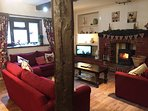 Brook house 2 spacious lounge with woodburner stove three comfy sofas and much character