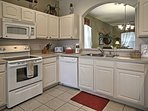 The fully equipped kitchen is ready for you to prepare a delicious home-cooked meal.