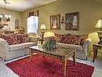 The formal living room is a quiet place to read a book or relax.