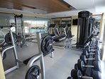The gym is located adjacent to the swimming pool on the 7th floor.