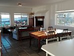 The living area includes a large braai (BBQ) which also serves as a fireplace