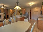 Enjoy a delicious meal at the dining table near the kitchen.