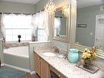 Elsa's Master Bathroom w/walk-in shower, dbl sinks, garden tub, and pool access!