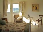 Relaxing bedrooms prettily furnished in the Mediterranean style.