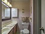 There is ample space to get ready for the day in this bathroom!