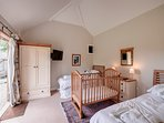 The twin bedroom in the Card Shed - linked to the double bedroom via the shared bathroom