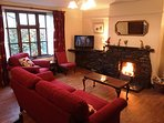 Large lovely lounge with super open fire in Jemima cottage