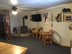 Lower level rec room, 50'/Xbox 360, fishing poles, Queen BR in rear of pic