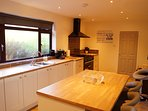 Kitchen with range cooker, coffee machine and Bose speaker