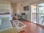 Bright and clean unit with a cozy sofa to relax and watch the flat screen cable TV.