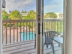 Enjoy the view from the deck overlooking the pool or catching a sunset.