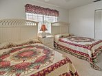 The 2 full beds can sleep up to 4 guests total.