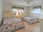 You'll have no problems falling asleep in this room that has a flat screen cable TV and 2 cozy full-sized beds.