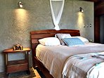 Spacious bedrooms with mosquito nets and ceiling fans