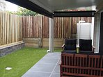 Back patio - fully fenced back yard with artificial grass.