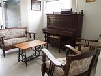 Formal Lounge room - the piano and chairs are all over 100 years old.