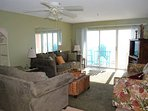 spacious living room with direct gulf views