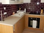 Fitted Kitchen with oven, hob, dishwasher and microwave