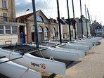 Book sailing lessons or hire sailing/ kayaking equipment on the seafront