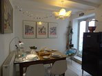 The dining room set for dinner on the original Cornish pasty making table