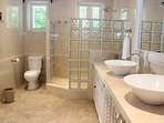 Master bathroom with walk in shower, Mahogany.