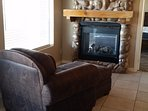 Double fireplace can be enjoyed from the master bedroom