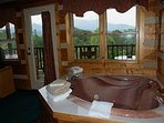 Romantic heart shaped jetted tub overlooks heavenly view