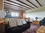 The sitting room has two comfortable leather sofas
