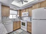 Bright, clean with granite counters, double stainless sink, full fridge, stove, oven and microwave.