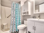 Master bath features walk in shower with safety bar.