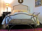 Bedroom has an adjustable queen sized bed on hardwood floors
