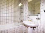 Spacious bathroom with bath tub