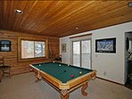 Game room with pool table and dart board