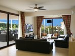 Spacious Lounge with Sliding Patio Doors Extending to the Outdoor Terrace, the Pool and the Gardens