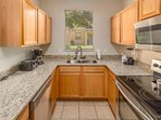Kitchen with brand new stainless steel appliances