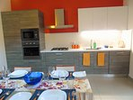 Modern, fully-equipped kitchen with oven, microwave, fridge.freezer & dishwasher