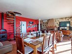 Dining and living area with fully equipped kitchen, fire place and amazing view at Split