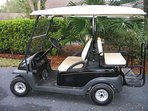 Nice Club Car golf cart for resort exploration and easy trips to the beach