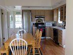 The fully-equipped kitchen, with high-end fridge, stove, dishwasher.
