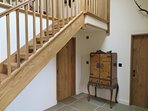 Open plan staircase leading to the sitting room snug.