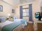 Another guest bedroom offers two twin size beds