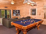 Game room has a pool table, foosball and PS4 game system