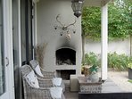A fireplace under the porch