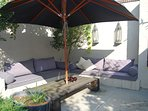 The lounge corner in the sunny backpart of the garden