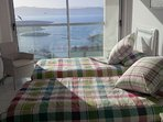 Second bedroom with twin beds and an amazing view of the sea