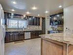 Granite Countertops and Dark Wood Cabinets