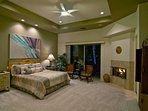 Master Suite with Fireplace at Night